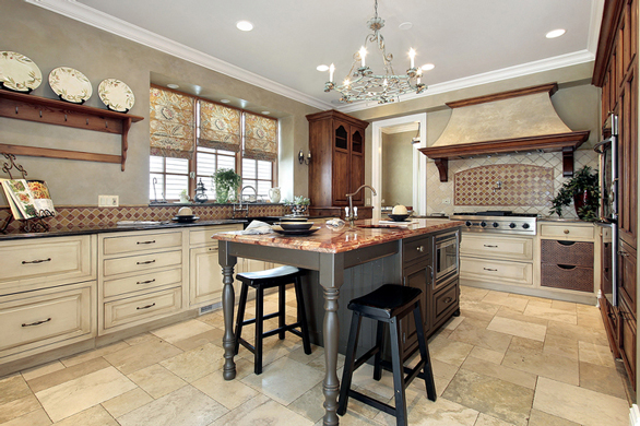 Photo of kitchen with granite counters and a marble island
